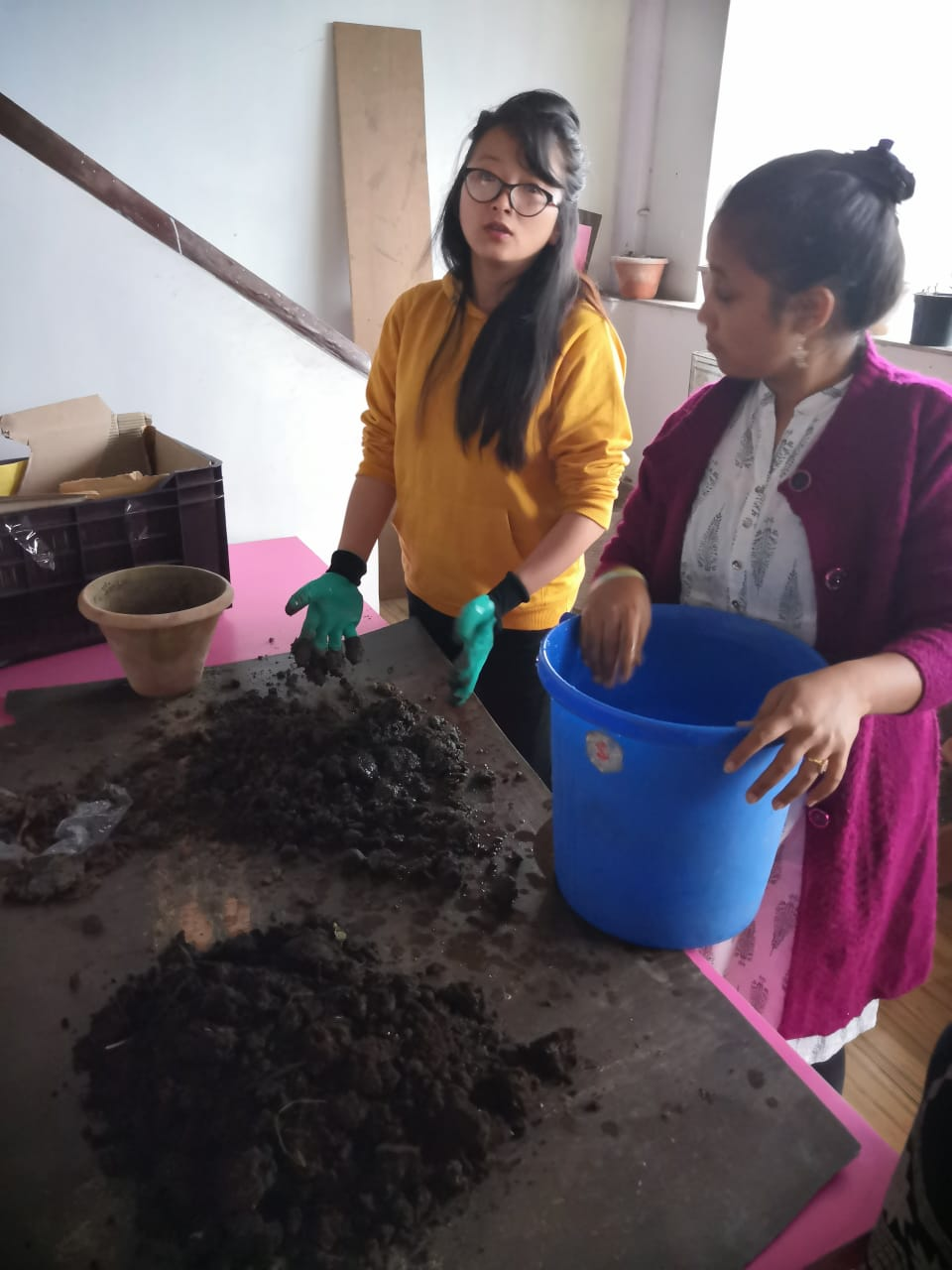 Junu Pundi Lepcha and Shobhna Gupta of the Sustainable Sikkim Team, setting up the Vermiculture Project