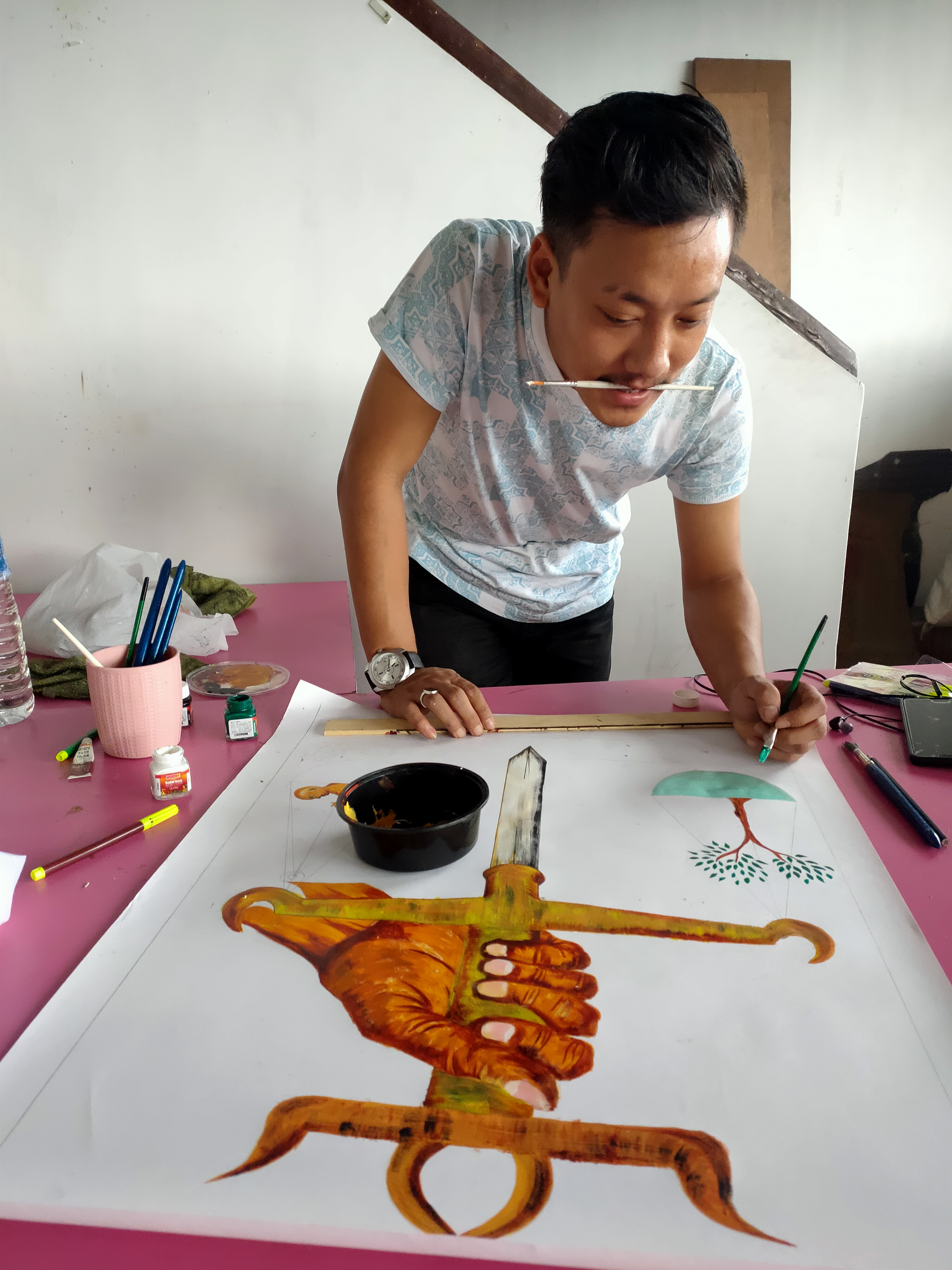 Ugen Lepcha preparing Climate Posters