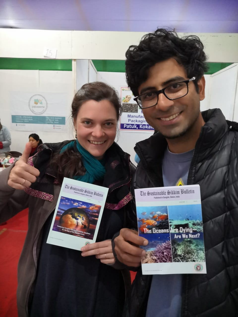 Mr. & Mrs. Giyanani, visitors from Germany, holding Sustainable Sikkim bulletins at the Trade Fair in Gangtok